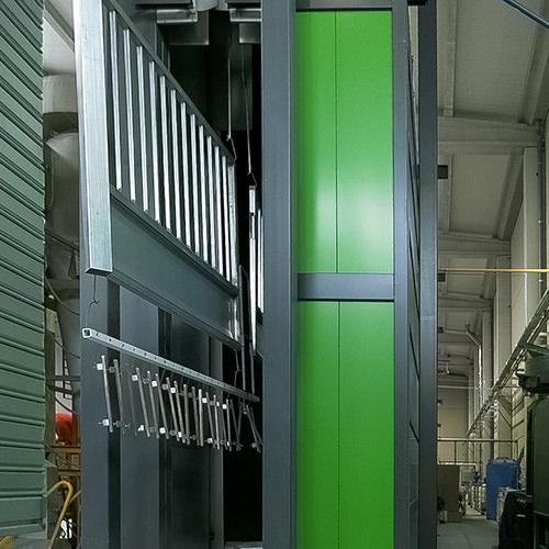 Aplicación de pintura en polvo en cabina automática robotizada